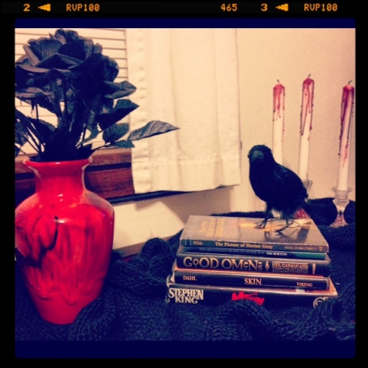 Raven, bloody candles and black flowers